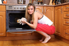 Woman cooking dinner Royalty Free Stock Photos
