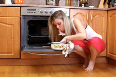 Woman cooking dinner Royalty Free Stock Images