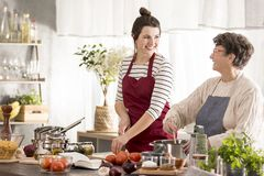 Woman cooking dinner with grandmother Stock Images