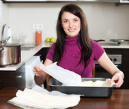Woman cooking with  dough Royalty Free Stock Photography