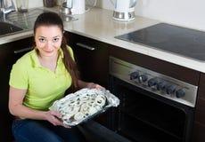Woman cooking fish at home Stock Photos