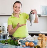 Woman cooking fish at home Stock Photography