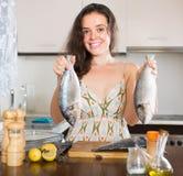 Woman cooking fish at kitchen Royalty Free Stock Photo