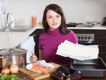 Woman cooking fish pie with  store-bought dough Stock Photos
