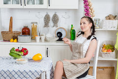 Woman cooking food in the kitchen. Royalty Free Stock Photography