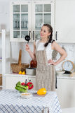 Woman cooking food in the kitchen. Stock Photography