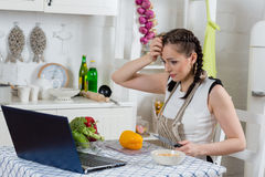 Woman cooking food in the kitchen. Stock Photos