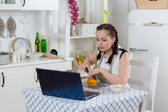 Woman cooking food in the kitchen. Royalty Free Stock Photos