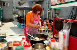 Pengzhou, China: Woman Cooking Food Stock Images