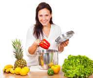 Woman is cooking fresh food Stock Image