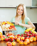 Woman cooking fruit salad Royalty Free Stock Photo