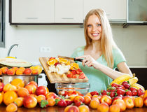 Woman cooking fruit salad Stock Photo