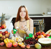 Woman cooking fruit salad with yoghurt Stock Photo