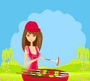 Woman cooking on a grill Stock Photos