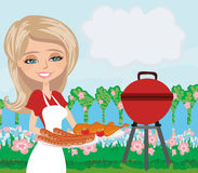 Woman cooking on a grill Royalty Free Stock Photos