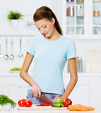 Woman cooking healthy food Stock Images