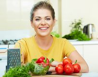 Woman cooking healthy food. In the kitchen Stock Image