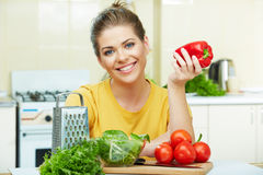 Woman cooking healthy food in the kitchen Royalty Free Stock Photography