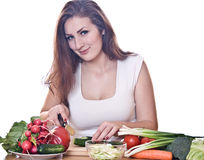 Woman cooking healthy food Stock Photography