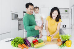 Woman cooking with her husband and kid Royalty Free Stock Photography