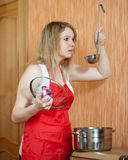 Woman cooking at her kitchen Stock Photography