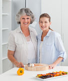Woman cooking with her mother Stock Image