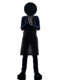 Woman cooking hiding behind frying pan silhouette Royalty Free Stock Image