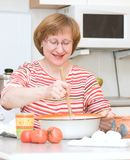 Woman cooking at home Royalty Free Stock Photo