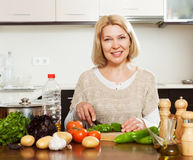 Woman cooking at home kitchen Royalty Free Stock Image
