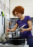 Woman cooking at home Royalty Free Stock Photos