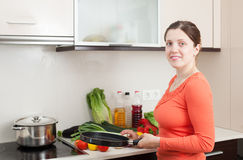 Woman cooking in home kitchen Royalty Free Stock Images