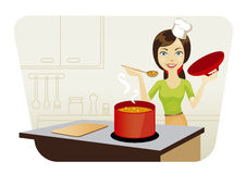 Woman cooking in the kitchen. Young beautiful woman cooking in kitchen Royalty Free Stock Photo