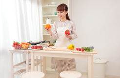 Woman cooking in kitchen Royalty Free Stock Photos