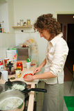 Woman cooking in the kitchen. Woman cooking in at home royalty free stock photo
