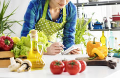 Woman cooking in the kitchen. Woman cooking in the  kitchen Stock Photos