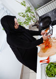 Woman cooking in the kitchen Royalty Free Stock Photography