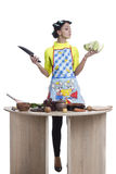 Woman cooking in kitchen Stock Photography