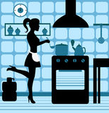 Woman cooking in the kitchen. Female silhouette standing at the stove in the kitchen cooking Royalty Free Stock Photography
