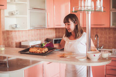 Woman cooking at kitchen Stock Image