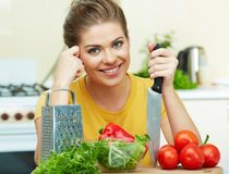 Woman cooking in the kitchen. Healthyfood Royalty Free Stock Image