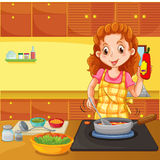 Woman cooking in kitchen Royalty Free Stock Image