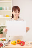 Woman cooking in kitchen with space for copy Stock Photography