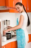 Woman cooking in the kitchen, tasting soup Stock Photos
