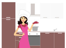 Woman cooking in the kitchen Royalty Free Stock Photos