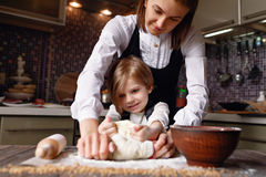 Woman cooking with little girl royalty free stock photography