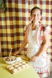Woman cooking meat pasty Stock Photography