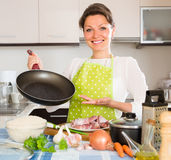 Woman cooking meat with rice Stock Photography