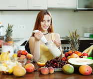 Woman cooking milkshake with fruits Stock Image
