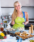 Woman cooking mussels at home Stock Photography