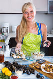 Woman cooking mussels at home Royalty Free Stock Photos